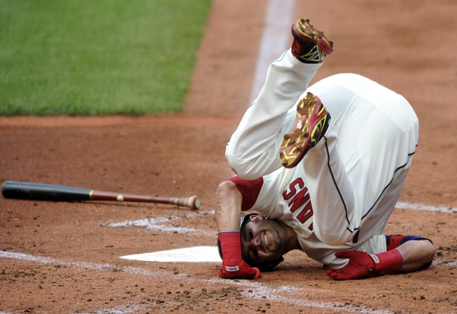 Jul 6, 2013; Cleveland, OH, USA; Cleveland Indians first baseman Nick Swisher (33) falls to the ground after being hit by a pitch in the second inning by Detroit Tigers starting pitcher Anibal Sanchez (not pictured) at Progressive Field. Mandatory Credit: David Richard-USA TODAY Sports