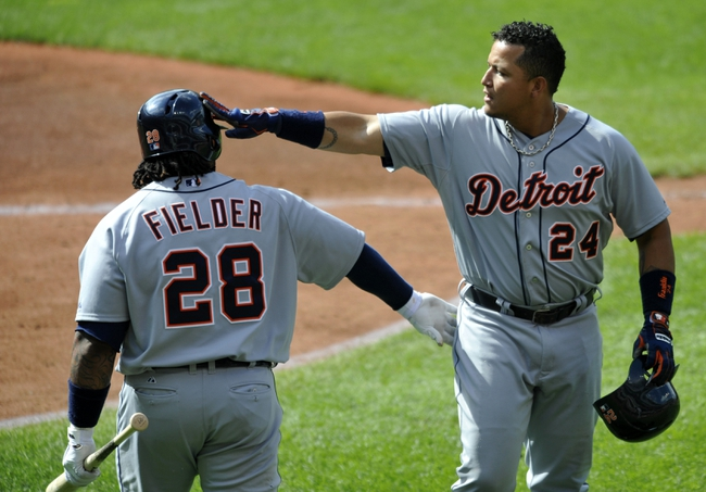 Jul 6, 2013; Cleveland, OH, USA; Detroit Tigers third baseman Miguel Cabrera (24) celebrates his two-run home run with first baseman Prince Fielder (28) in the third inning against the Cleveland Indians at Progressive Field. Mandatory Credit: David Richard-USA TODAY Sports