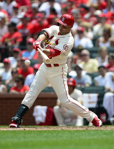 Jul 6, 2013; St. Louis, MO, USA; St. Louis Cardinals right fielder Carlos Beltran (3) hits a one run single off of Miami Marlins starting pitcher Nate Eovaldi (not pictured) during the third inning at Busch Stadium. St. Louis defeated Miami 5-4. Mandatory Credit: Jeff Curry-USA TODAY Sports