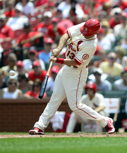 Jul 6, 2013; St. Louis, MO, USA; St. Louis Cardinals second baseman Matt Carpenter (13) hits a one run triple off of Miami Marlins starting pitcher Nate Eovaldi (not pictured) during the third inning at Busch Stadium. St. Louis defeated Miami 5-4. Mandatory Credit: Jeff Curry-USA TODAY Sports