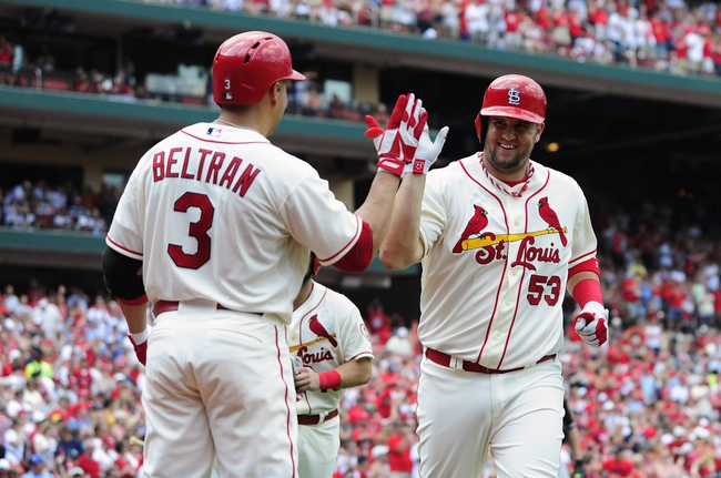 Jul 6, 2013; St. Louis, MO, USA; St. Louis Cardinals pinch hitter Matt Adams (53)  is congratulated by right fielder Carlos Beltran (3) after he hit a game tying two run home run off of Miami Marlins relief pitcher Mike Dunn (not pictured) during the seventh inning at Busch Stadium. St. Louis defeated Miami 5-4. Mandatory Credit: Jeff Curry-USA TODAY Sports