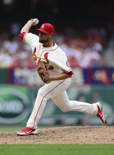 Jul 6, 2013; St. Louis, MO, USA; St. Louis Cardinals relief pitcher Edward Mujica (44) throws to a Miami Marlins batter during the ninth inning at Busch Stadium. St. Louis defeated Miami 5-4. Mandatory Credit: Jeff Curry-USA TODAY Sports