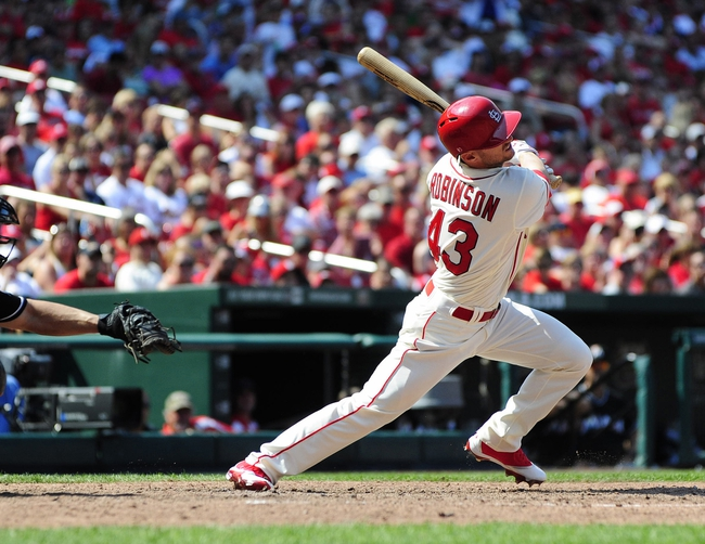 Jul 6, 2013; St. Louis, MO, USA; St. Louis Cardinals right fielder Shane Robinson (43) hits a walk off single that lead to a throwing error by Miami Marlins right fielder Giancarlo Stanton (not pictured) that allowed center fielder Jon Jay (not pictured) during the ninth inning at Busch Stadium. St. Louis defeated Miami 5-4. Mandatory Credit: Jeff Curry-USA TODAY Sports