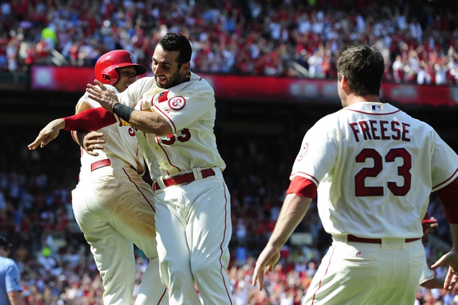 Jul 6, 2013; St. Louis, MO, USA; St. Louis Cardinals center fielder Jon Jay (19) celebrates with shortstop Daniel Descalso (33) after scoring the game winning run on a throwing error by Miami Marlins right fielder Giancarlo Stanton (not pictured) during the ninth inning at Busch Stadium. St. Louis defeated Miami 5-4. Mandatory Credit: Jeff Curry-USA TODAY Sports
