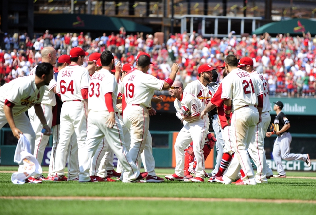 Jul 6, 2013; St. Louis, MO, USA; St. Louis Cardinals right fielder Shane Robinson (43) celebrates with teammates after hitting a walk off single that lead to a throwing error by Miami Marlins right fielder Giancarlo Stanton (not pictured) that allowed center fielder Jon Jay (not pictured) during the ninth inning at Busch Stadium. St. Louis defeated Miami 5-4. Mandatory Credit: Jeff Curry-USA TODAY Sports