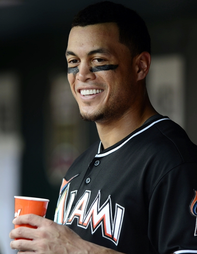 Jul 6, 2013; St. Louis, MO, USA; Miami Marlins right fielder Giancarlo Stanton (27) talks to teammates in the dug out during the third inning against the St. Louis Cardinals at Busch Stadium. St. Louis defeated Miami 5-4. Mandatory Credit: Jeff Curry-USA TODAY Sports