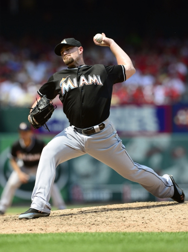 Jul 6, 2013; St. Louis, MO, USA; Miami Marlins relief pitcher Mike Dunn (40) throws to a St. Louis Cardinals batter during the seventh inning at Busch Stadium. St. Louis defeated Miami 5-4. Mandatory Credit: Jeff Curry-USA TODAY Sports