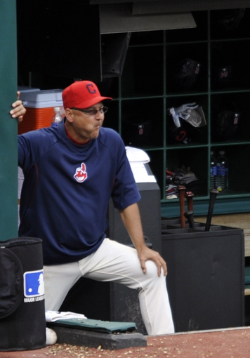 Jul 6, 2013; Cleveland, OH, USA; Cleveland Indians manager Terry Francona (17) watches from the dugout in the seventh inning against the Detroit Tigers at Progressive Field. Mandatory Credit: David Richard-USA TODAY Sports