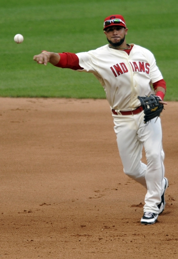 Jul 6, 2013; Cleveland, OH, USA; Cleveland Indians shortstop Mike Aviles (4) throws out Detroit Tigers second baseman Ramon Santiago (not pictured) in the seventh inning at Progressive Field. Mandatory Credit: David Richard-USA TODAY Sports