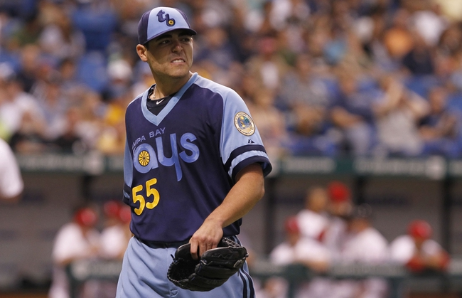 Jul 6, 2013; St. Petersburg, FL, USA; Tampa Bay Rays starting pitcher Matt Moore (55) reacts after he pitched the first inning against the Chicago White Sox at Tropicana Field. Mandatory Credit: Kim Klement-USA TODAY Sports