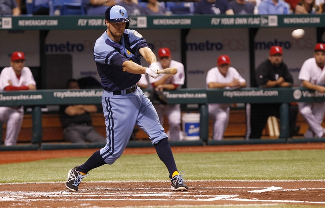 Jul 6, 2013; St. Petersburg, FL, USA; Tampa Bay Rays second baseman Ben Zobrist (18) singles during the first inning against the Chicago White Sox at Tropicana Field. Mandatory Credit: Kim Klement-USA TODAY Sports