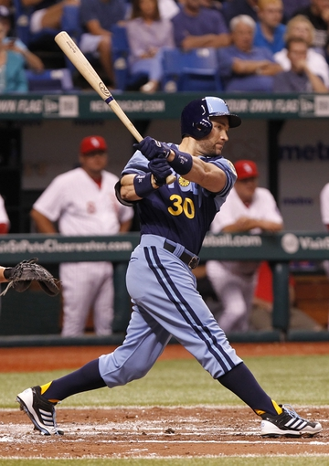 Jul 6, 2013; St. Petersburg, FL, USA; Tampa Bay Rays designated hitter Luke Scott (30) hits a RBI double during the second inning against the Chicago White Sox at Tropicana Field. Mandatory Credit: Kim Klement-USA TODAY Sports