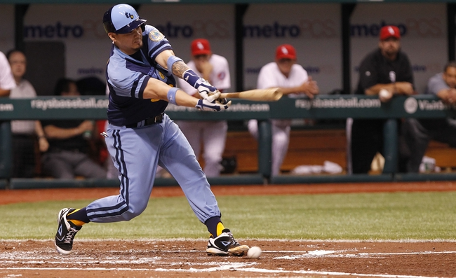 Jul 6, 2013; St. Petersburg, FL, USA; Tampa Bay Rays catcher Jose Lobaton (59) singles during the second inning against the Chicago White Sox at Tropicana Field. Mandatory Credit: Kim Klement-USA TODAY Sports