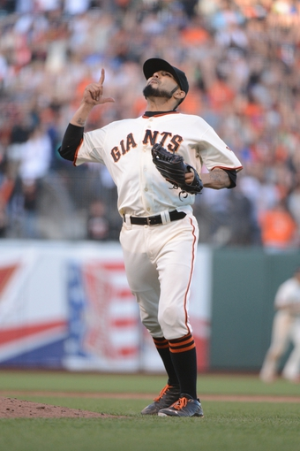 July 6, 2013; San Francisco, CA, USA; San Francisco Giants relief pitcher Sergio Romo (54) celebrates after the game against the Los Angeles Dodgers at AT&T Park. The Giants defeated the Dodgers 4-2. Mandatory Credit: Kyle Terada-USA TODAY Sports