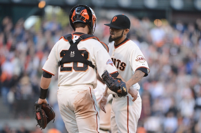 July 6, 2013; San Francisco, CA, USA; San Francisco Giants catcher Buster Posey (28, left) and relief pitcher Sergio Romo (54, right) celebrate after the game against the Los Angeles Dodgers at AT&T Park. The Giants defeated the Dodgers 4-2. Mandatory Credit: Kyle Terada-USA TODAY Sports
