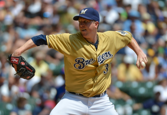 Jul 7, 2013; Milwaukee, WI, USA;  Milwaukee Brewers pitcher Tom Gorzelanny pitches against the New York Mets in the 1st inning at Miller Park. Mandatory Credit: Benny Sieu-USA TODAY Sports