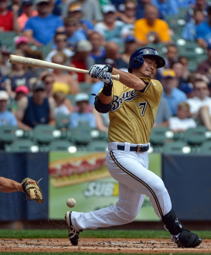 Jul 7, 2013; Milwaukee, WI, USA;  Milwaukee Brewers right fielder Norichika Aoki fouls a pitch off his foot in the 1st inning during the game against the New York Mets at Miller Park. Mandatory Credit: Benny Sieu-USA TODAY Sports