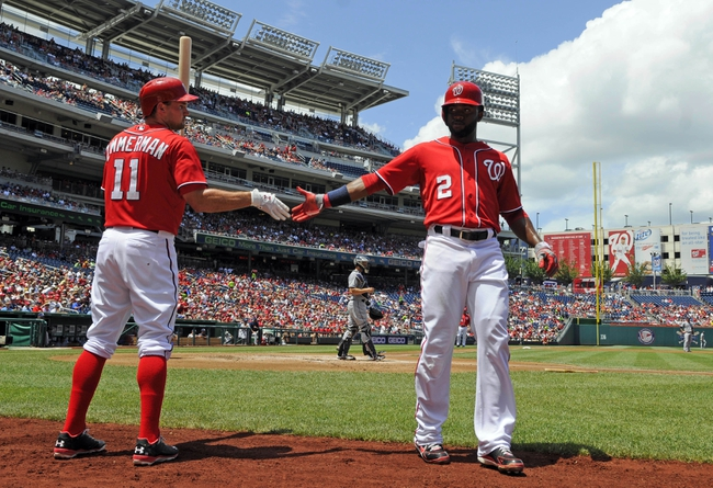 Jul 7, 2013; Washington, DC, USA; Washington Nationals center fielder Denard Span (2) is congratulated by Ryan Zimmerman (11) after scoring a run during the first inning against the San Diego Padres at Nationals Park. Mandatory Credit: Brad Mills-USA TODAY Sports