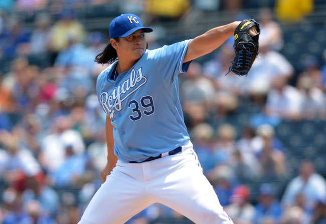 Jul 7, 2013; Kansas City, MO, USA; Kansas City Royals starting pitcher Luis Mendoza (39) delivers a pitch in the first inning of the game against the Oakland Athletics at Kauffman Stadium. Mandatory Credit: Denny Medley-USA TODAY Sports