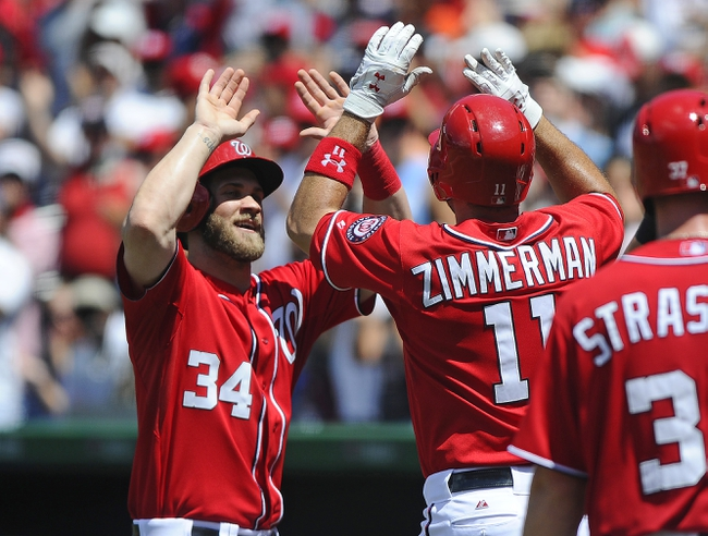 Jul 7, 2013; Washington, DC, USA; Washington Nationals third baseman Ryan Zimmerman (11) is congratulated by  Bryce Harper (34) after hitting a grand slam during the third inning against the San Diego Padres at Nationals Park. Mandatory Credit: Brad Mills-USA TODAY Sports