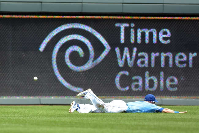 Jul 7, 2013; Kansas City, MO, USA; Kansas City Royals left fielder Alex Gordon (4) can't make the stop in left field in the second inning of the game against the Oakland Athletics at Kauffman Stadium. Mandatory Credit: Denny Medley-USA TODAY Sports