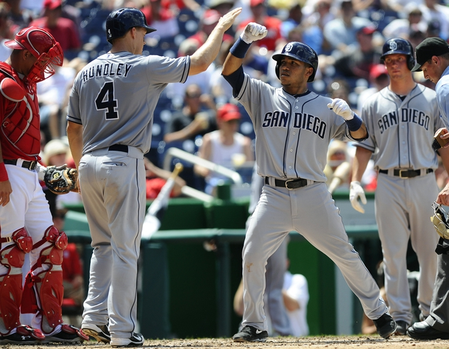 Jul 7, 2013; Washington, DC, USA; San Diego Padres second baseman Alexi Amarista (5) is congratulated by Nick Hundley (4) after hitting a two run homer during the fourth inning against the Washington Nationals at Nationals Park.  Mandatory Credit: Brad Mills-USA TODAY Sports