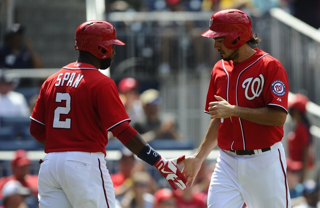 Jul 7, 2013; Washington, DC, USA; Washington Nationals second baseman Anthony Rendon (6) is congratulated by Denard Span (2) after scoring a run during the fifth inning against the San Diego Padres at Nationals Park. Mandatory Credit: Brad Mills-USA TODAY Sports