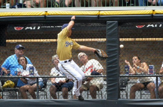 Jul 7, 2013; Milwaukee, WI, USA;  Milwaukee Brewers right fielder Norichika Aoki can't catch ball hit for a double by New York Mets first baseman Josh Satin (not pictured) in the 6th inning at Miller Park. Mandatory Credit: Benny Sieu-USA TODAY Sports