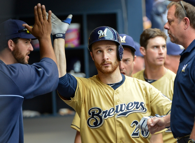 Jul 7, 2013; Milwaukee, WI, USA;  Milwaukee Brewers catcher Jonathan Lucroy is greeted in the dugout after hitting a solo home run in the 7th inning against the New York Mets at Miller Park. Mandatory Credit: Benny Sieu-USA TODAY Sports