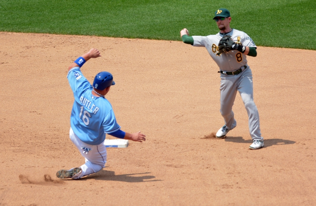 Jul 7, 2013; Kansas City, MO, USA; Oakland Athletics shortstop Jed Lowrie (8) gets the force out on Kansas City Royals designated hitter Billy Butler (16) at second base and throws to first in the fourth inning at Kauffman Stadium. Mandatory Credit: Denny Medley-USA TODAY Sports