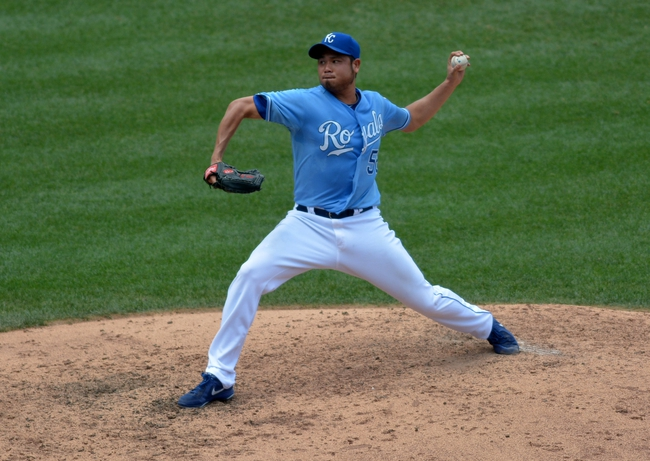 Jul 7, 2013; Kansas City, MO, USA; Kansas City Royals relief pitcher Bruce Chen (52) delivers a pitch in the fifth inning of the game against the Oakland Athletics at Kauffman Stadium. Mandatory Credit: Denny Medley-USA TODAY Sports
