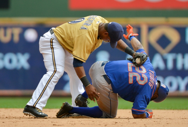 Jul 7, 2013; Milwaukee, WI, USA;  New York Mets left fielder Eric Young Jr. (22) steals second base as Milwaukee Brewers shortstop Jean Segura (9) is late with the tag in the 5th inning at Miller Park. Mandatory Credit: Benny Sieu-USA TODAY Sports