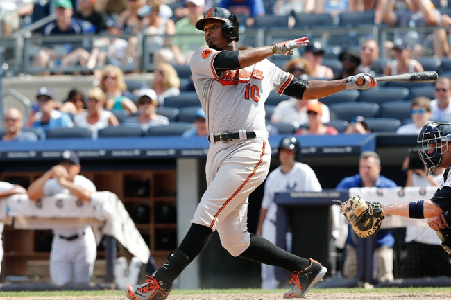 Jul 7, 2013; Bronx, NY, USA;  Baltimore Orioles center fielder Adam Jones (10) hits a home run to left center allowing a runner to score during the ninth inning against the New York Yankees at Yankee Stadium. Baltimore Orioles won 2-1.  Mandatory Credit: Anthony Gruppuso-USA TODAY Sports