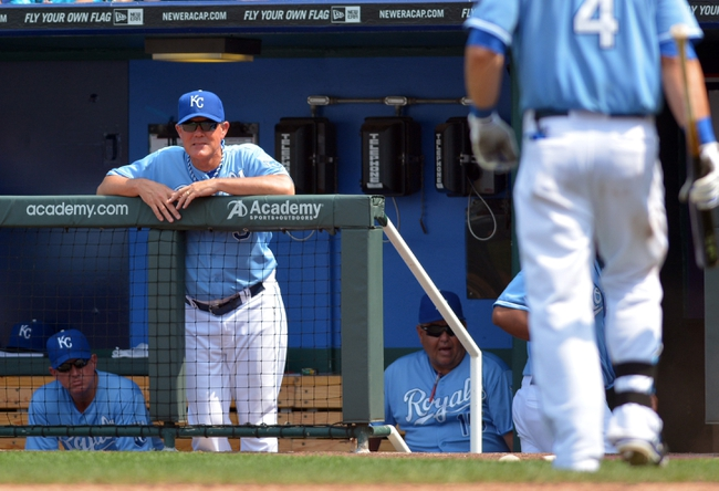 Jul 7, 2013; Kansas City, MO, USA; Kansas City Royals manager Ned Yost (3) watches play as left fielder Alex Gordon (4) walks to the dugout after striking out in the sixth inning of the game against the Oakland Athletics at Kauffman Stadium. Mandatory Credit: Denny Medley-USA TODAY Sports