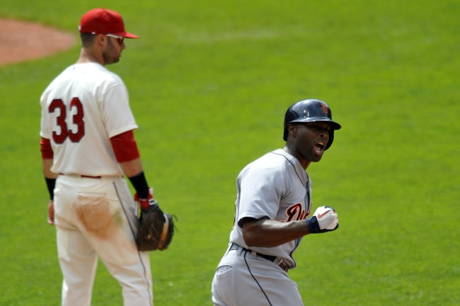 Jul 7, 2013; Cleveland, OH, USA; Detroit Tigers right fielder Torii Hunter (48) celebrates his three-run home run beside Cleveland Indians first baseman Nick Swisher (33) in the eighth inning at Progressive Field. Mandatory Credit: David Richard-USA TODAY Sports