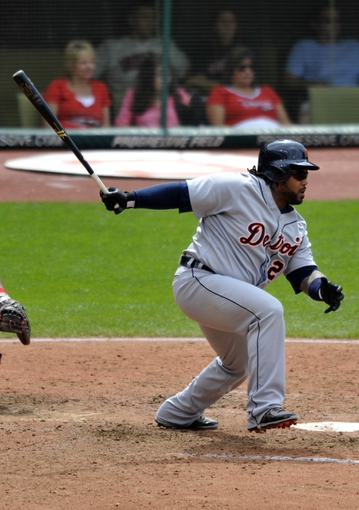 Jul 7, 2013; Cleveland, OH, USA; Detroit Tigers first baseman Prince Fielder (28) singles in the eighth inning against the Cleveland Indians at Progressive Field. Mandatory Credit: David Richard-USA TODAY Sports
