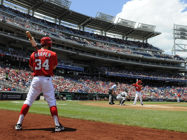 Jul 7, 2013; Washington, DC, USA; Washington Nationals left fielder Bryce Harper (34) waits on deck as Ian Desmond (20) bats during the first inning against the San Diego Padres at Nationals Park. Mandatory Credit: Brad Mills-USA TODAY Sports