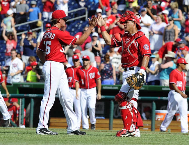 Jul 7, 2013; Washington, DC, USA; Washington Nationals relief pitcher Tyler Clippard (36) is congratulated by catcher Wilson Ramos (40) after recording the final out against the San Diego Padres at Nationals Park. Mandatory Credit: Brad Mills-USA TODAY Sports