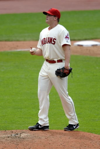 Jul 7, 2013; Cleveland, OH, USA; Cleveland Indians relief pitcher Vinnie Pestano (52) reacts while being taken from the game in the eighth inning against the Detroit Tigers at Progressive Field. Mandatory Credit: David Richard-USA TODAY Sports