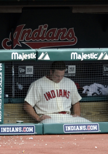 Jul 7, 2013; Cleveland, OH, USA; Cleveland Indians relief pitcher Vinnie Pestano (52) sits in the dugout in the eighth inning after blowing a save against the Detroit Tigers at Progressive Field. Mandatory Credit: David Richard-USA TODAY Sports