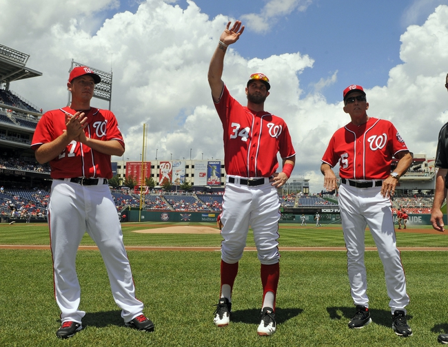 Jul 7, 2013; Washington, DC, USA; Washington Nationals all star game participants Jordan Zimmermann (27) and Bryce Harper (34) and Davey Johnson are introduced before the game against the San Diego Padres at Nationals Park. Mandatory Credit: Brad Mills-USA TODAY Sports