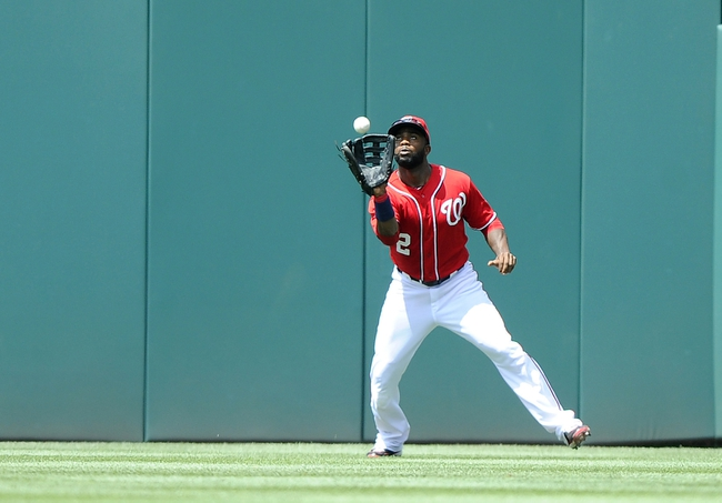 Jul 7, 2013; Washington, DC, USA; Washington Nationals center fielder Denard Span (2) catches the fly ball hit by San Diego Padres right fielder Kyle Blanks (not shown) during the fourth inning at Nationals Park. Mandatory Credit: Brad Mills-USA TODAY Sports