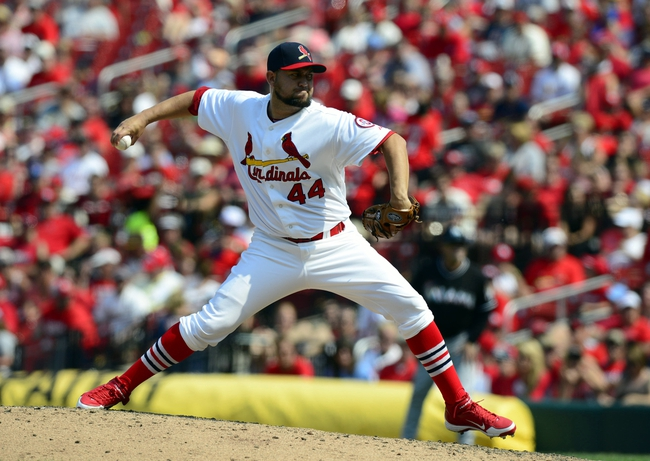 Jul 7, 2013; St. Louis, MO, USA; St. Louis Cardinals relief pitcher Edward Mujica (44) throws to a Miami Marlins batter during the ninth inning at Busch Stadium. St. Louis defeated Miami 3-2. Mandatory Credit: Jeff Curry-USA TODAY Sports