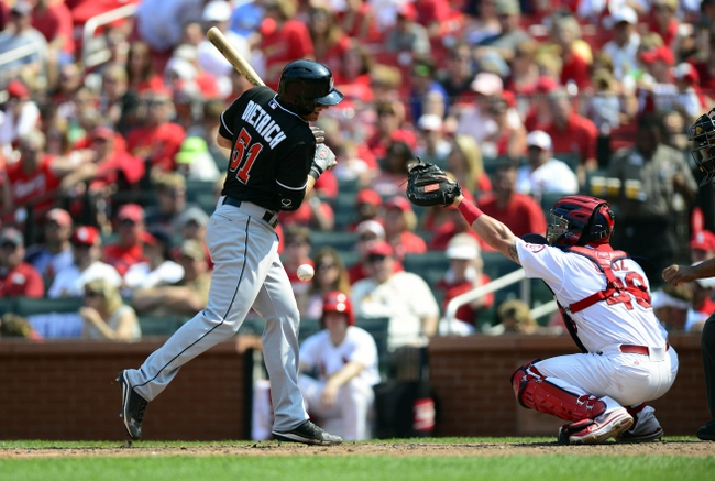 Jul 7, 2013; St. Louis, MO, USA; Miami Marlins second baseman Derek Dietrich (51) is hit by a pitch from St. Louis Cardinals relief pitcher Trevor Rosenthal (not pictured) during the eighth inning at Busch Stadium. St. Louis defeated Miami 3-2. Mandatory Credit: Jeff Curry-USA TODAY Sports