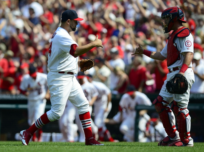 Jul 7, 2013; St. Louis, MO, USA; St. Louis Cardinals relief pitcher Edward Mujica (44) celebrates with catcher Tony Cruz (48) after defeating the Miami Marlins at Busch Stadium. St. Louis defeated Miami 3-2. Mandatory Credit: Jeff Curry-USA TODAY Sports