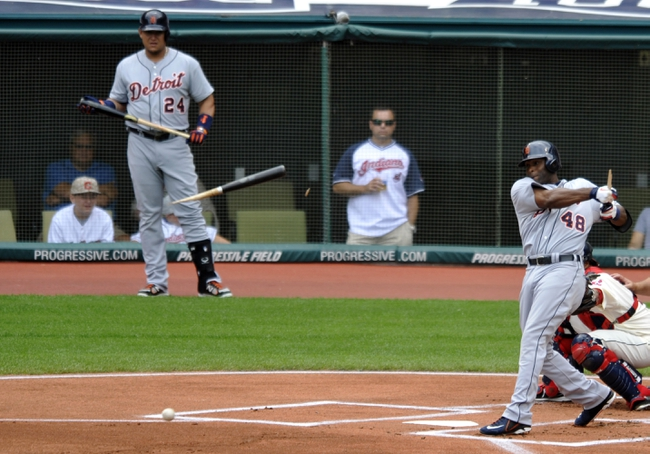 Jul 7, 2013; Cleveland, OH, USA; Detroit Tigers third baseman Miguel Cabrera (24) watches as right fielder Torii Hunter (48) breaks his bat on a swing in the first inning against the Cleveland Indians at Progressive Field. Mandatory Credit: David Richard-USA TODAY Sports
