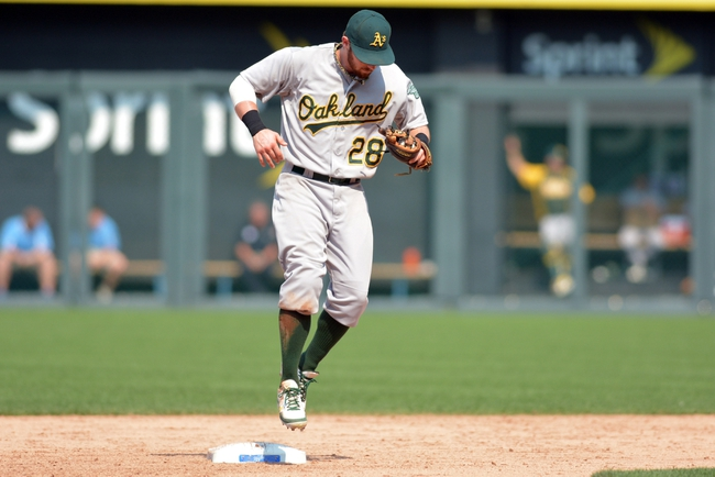 Jul 7, 2013; Kansas City, MO, USA; Oakland Athletics second baseman Eric Sogard (28) tags second base for the final out in the game against the Kansas City Royals at Kauffman Stadium. Oakland won 10-4. Mandatory Credit: Denny Medley-USA TODAY Sports