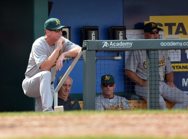 Jul 7, 2013; Kansas City, MO, USA; Oakland Athletics manager Bob Melvin (6) watches play from the dugout in the eighth inning of the game against the Kansas City Royals at Kauffman Stadium. Oakland won 10-4. Mandatory Credit: Denny Medley-USA TODAY Sports
