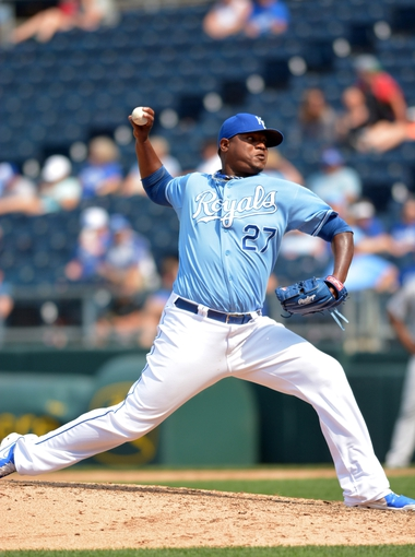 Jul 7, 2013; Kansas City, MO, USA; Kansas City Royals relief pitcher J.C. Gutierrez (27) delivers a pitch in the ninth inning of the game against the Oakland Athletics at Kauffman Stadium. Oakland won 10-4. Mandatory Credit: Denny Medley-USA TODAY Sports
