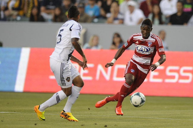 Jul 7, 2013; Carson, CA, USA; FC Dallas forward Fabian Castillo (11) moves the ball defended by Los Angeles Galaxy defender Sean Franklin (5) during the first half at the StubHub Center. Mandatory Credit: Kelvin Kuo-USA TODAY Sports